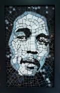 TÍTULO: Bob Marley DIMENSÕES: 31x18 cm VALOR: R$ 720,00 DESCRIÇÃO: Quadro. 2009. Contemporâneo em vidro. Moldura em madeira.